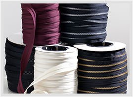 Spools of continuous zipper chain sold by the yard